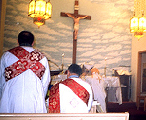 Prostration of the priest, at the consecration of the bread