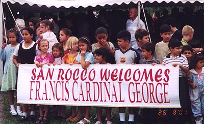 Children welcoming Cardinal George