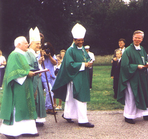 Deacon John Leonas, Cardinal George, Bishop Perry, and Father Gilligan