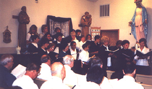 Woodsong Chorale, with men in pews